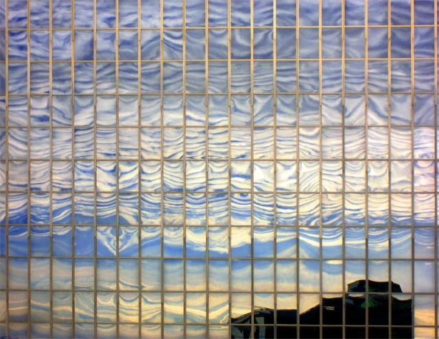 I took my camera to our office roof to shoot some weird clouds. They looked best reflected on a nearby building.