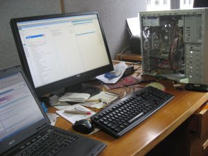 My office computer going again after XP was reinstalled. The computer case is still open after I put a new hard drive into it.