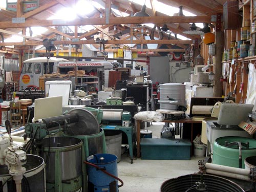 Inside a huge new building to accommodate some of the larger items. Old fridges, electric ranges, washing machines, an old printer's linotype machine, a not so ancient fax machine (1985) that is nevertheless enormous, horse gear, steam engine, portable boiler, replica viking ship and more.