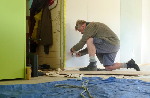 Bill Stephens doing his sparky thing, installing power points.