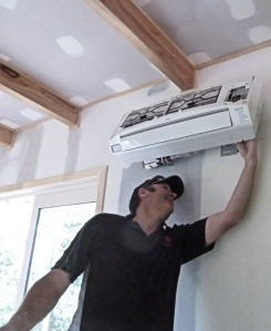 Glenn installing the heat pump. It's cooling abilioty was welcome while I worked on the ceiling.