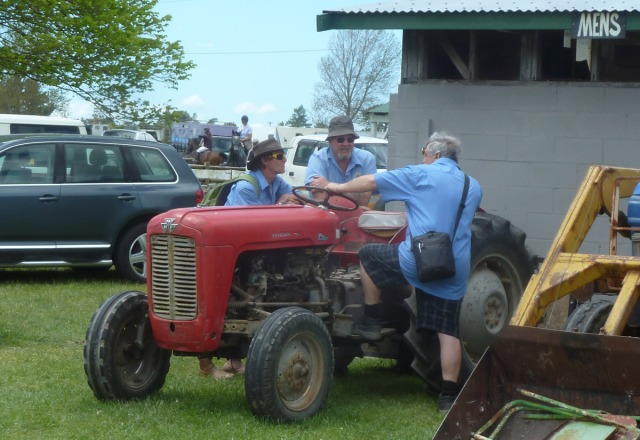 Old boys and their antique toys: yarning round an old Massey-Ferguson tractor.